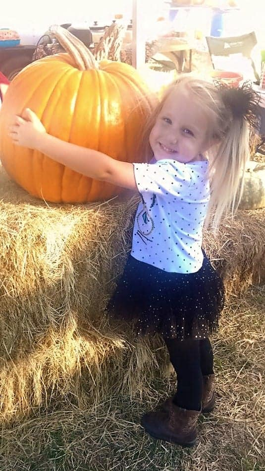 Team Family Farms Girl with Pumpkin
