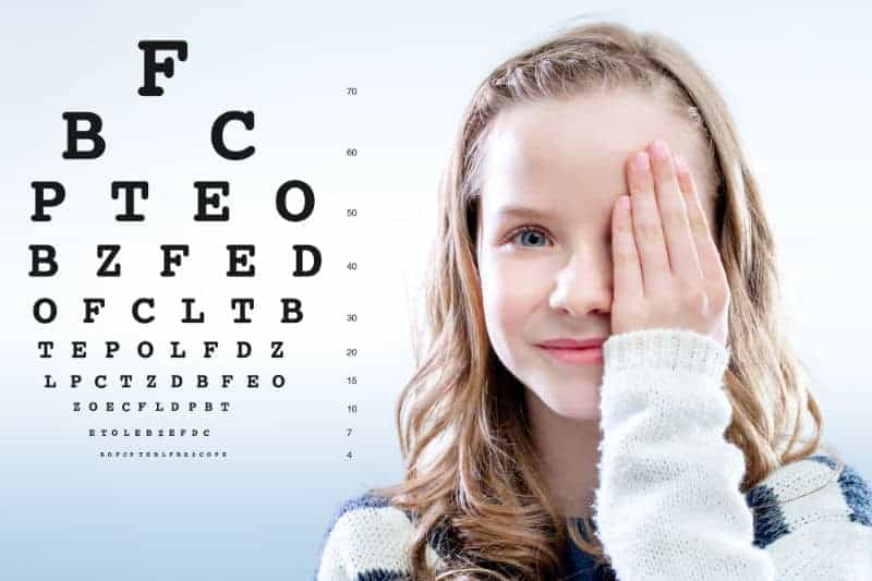 Plano girl having eye doctor test