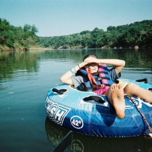 Kid floating on the Brazos River