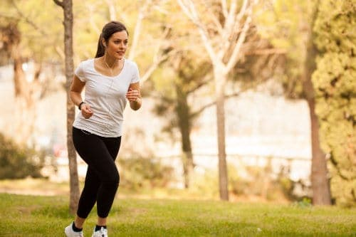 Woman running in Plano